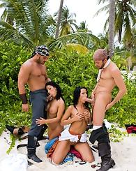 Two beautiful girls in beach outdoor foursome fucking hard
